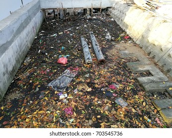 Drainage blocked by food waste, trash, garbage and rubbish, poor waste management.