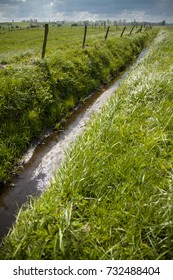 drainage ditch on meadow or rural landscape
