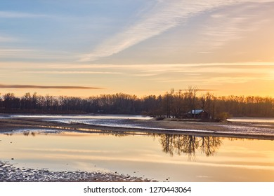 Drained pond Svět with reflection at sunset in Trebon in winter
