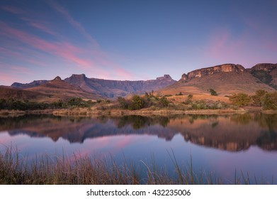 Drakensberg Amphitheatre on a beautiful morning at Royal Natal National Park in South Africa with a reflection in the water in the foreground
