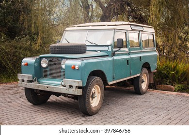 Drakensberg, South Africa - 25 March, 2016: Land Rover old model 4 W vehicle in Golden Gate Highlands National Park of South Africa. Vintage off-road car style. African autumn.