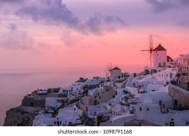 Drama before Sunset . The shot is taken at Oia,Santorini at Greece.The lovely colors of the sky are just before the sunset about to happen.People come hours early to grab a perfect place for Sunset.