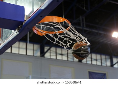 DRAMA, GREECE - OCT 12: A basketball falls through the net for a basket during the KAOD vs ARIS game for the Greek Basket League on October 13, 2013 in Drama, Greece