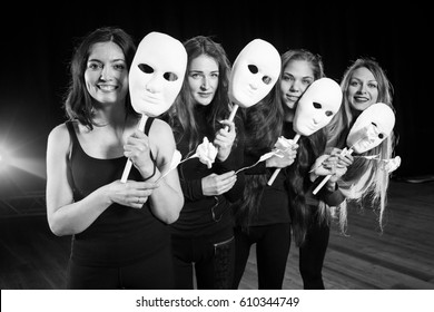 Drama on stage in theater. theater group on stage. Masks on stage in theater. Actress girls with masks.
