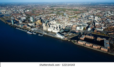 Dramatic aerial view of Liverpool with Mersey river in foreground