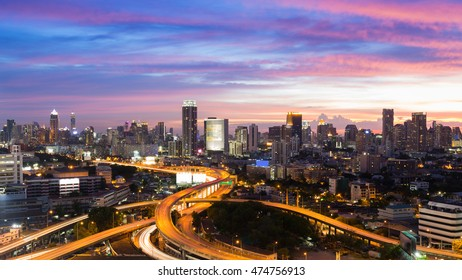 Dramatic after sunset sky,  aerial view highway interchanged with city downtown background