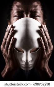 Dramatic art portrait of african black man with white mask.