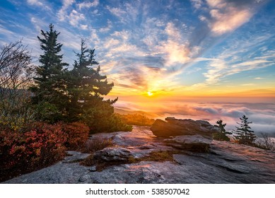 A dramatic autumn sunrise from Beacon Heights overlook along the Blue Ridge Parkway in North Carolina