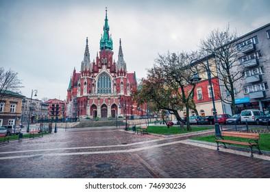Dramatic autumn view of Parish of St. Joseph church. Rainy morning cityscape of Krakow, Poland, Europe. Traveling concept background.
