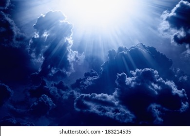 Dramatic background - dark blue sky with bright sun, light from heaven