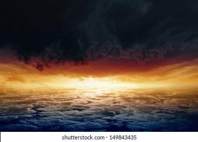 Dramatic background - red sunset, glowing horizon, dark clouds