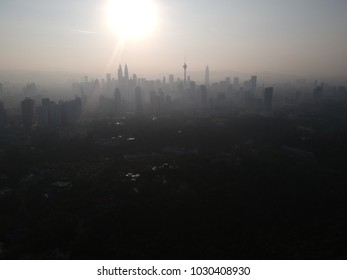 Dramatic and beautiful aerial view Kuala Lumpur city in the morning with the silhouette of Kuala Lumpur city skyline.