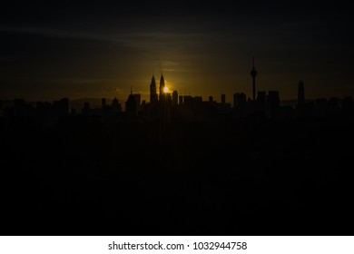 Dramatic and beautiful aerial view Kuala Lumpur city in the morning with the silhouette of Kuala Lumpur city skyline