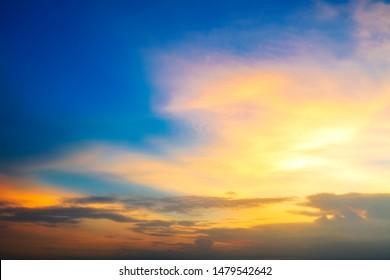 Dramatic beautiful sunset. Orange and yellow colors sky light. - Image