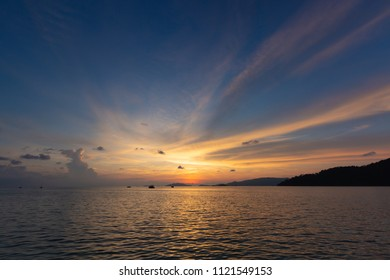 Dramatic beautiful sunset sky in golden hour on the sea beach background.