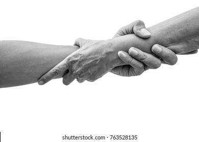 Dramatic black and white help hands holding together representing friendship, partnership, help and hope, donation, assistance.
