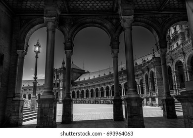 dramatic black and white for la Plaza de España , in seville , spain