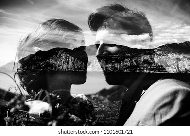 Dramatic black and white picture of a wedding couple and mountains behind them