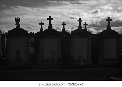 Dramatic black & white silhouette of New Orleans above ground cemetery