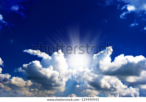 dramatic blue sky with clouds and sun rays