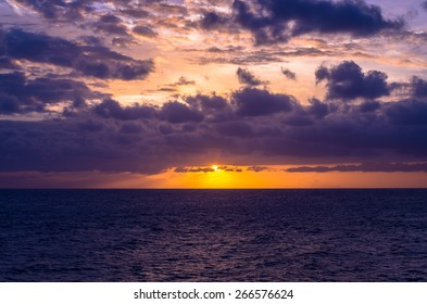 Dramatic bluish sunset over the ocean