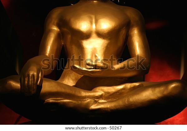 Dramatic Buddha's torso