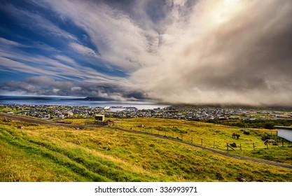 Dramatic change of weather over Torshavn, the capital and largest city of the Faroe Islands, Denmark. Hdr processed.