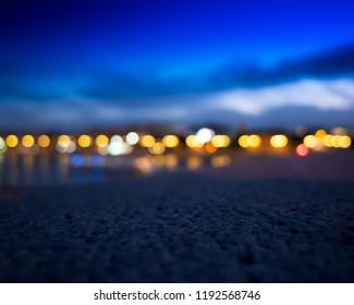 Dramatic city lights at horizon level bokeh background