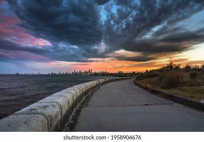 dramatic city sunrise Elwood beach Melbourne skyline coastal ocean bay