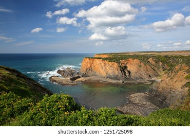 Dramatic cliffs on Alentejo West Coast in Porto das Barcas, Zambujeira do Mar, Alentejo, Portugal
