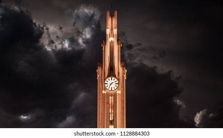 Dramatic clock tower with a storm