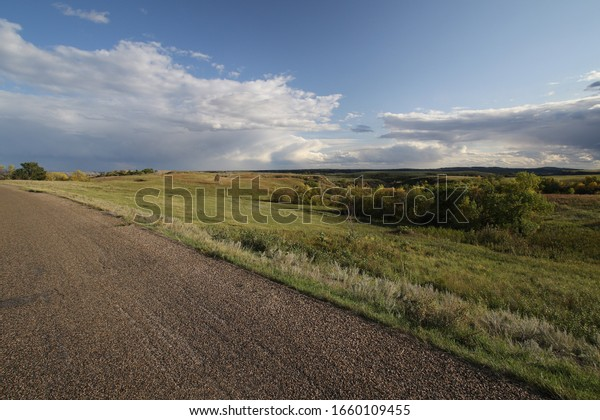 dramatic cloud formation over lonely street in south dakota, usa