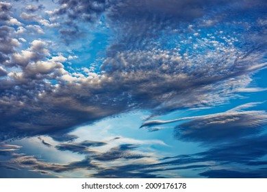 Dramatic clouds just after a storm. Textured and contrasted to a blue sky.