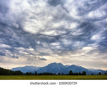 Dramatic clouds in the mountain valley. Spring storm landscape in Italy