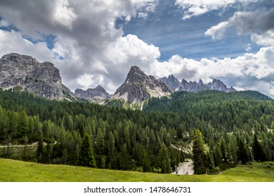 Dramatic clouds over the dolomites in the italian alps at a sunny but windy day in summer.