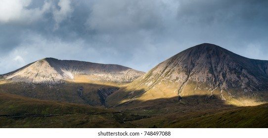 Dramatic clouds over Glamaig with sunlight spots