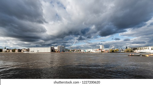 Dramatic clouds over landscape of river Thames by Wandsworth Bridge, London