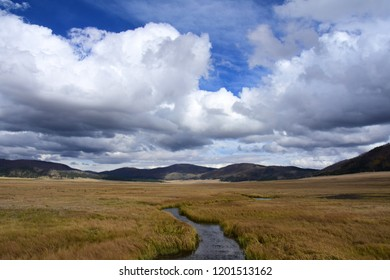dramatic clouds over the  mountain meadow at valles caldera national preserve, near los alamos, new mexico