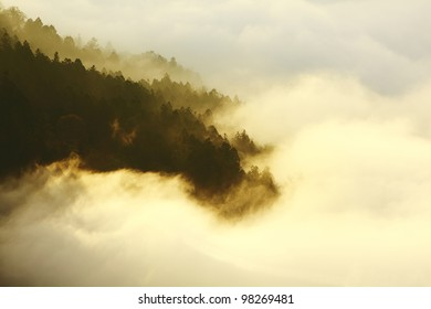 dramatic Clouds rolling over mountains at sunset shot in taiwan formosa asia