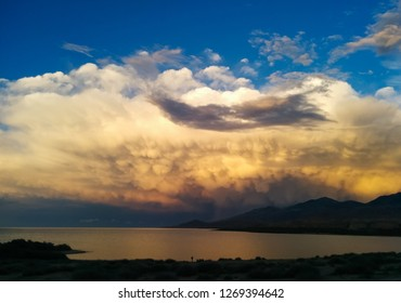 Dramatic clouds and scenic sunset view of issyk kul lake coast