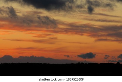 Dramatic cloudy sky. Beautiful red sunset. Very clear and bright perspective with clouds layers that accentuate the horizon.