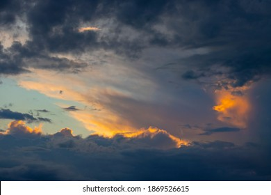 Dramatic cloudy sky. Beautiful sunset. Frame from clouds, several sun rays penetrates the clouds.
