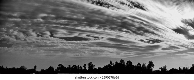 A dramatic cloudy sky unique black and white photo