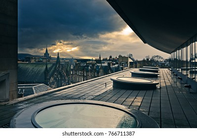 Dramatic cloudy sunset from a rooftop