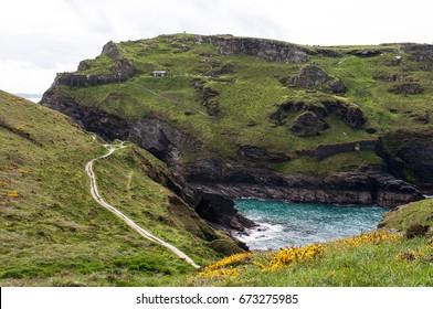 Dramatic coast path around the honeypot centre of Tintagel from Boscastle. Cornwall, England, United Kingdom
