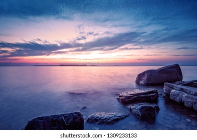 Dramatic coastal sunset. Blue hour on Lake Michigan, Door County, Wisconsin