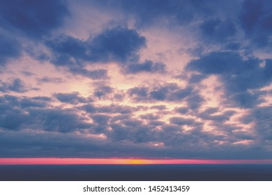 Dramatic colorful cloudy sky at sunset.