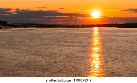 Dramatic colorful golden susnet on the Volga river. Evening time, warm illumination. Calm, peaceful, atmospheric view, relaxation concept