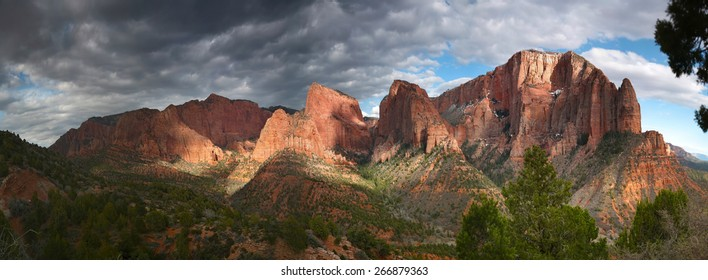 Dramatic and colorful panoramic sunset of timber Top Mountain and Shuntavi Butte in the Kolob Canyon District - Zion National Park, Utah, USA
