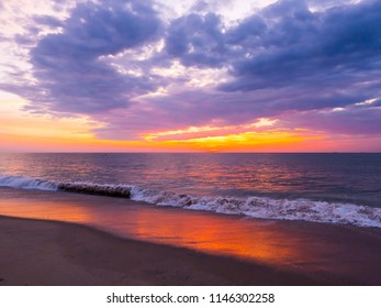 Dramatic and colorful sunrise along the beach of Bethany Beach, Delaware.